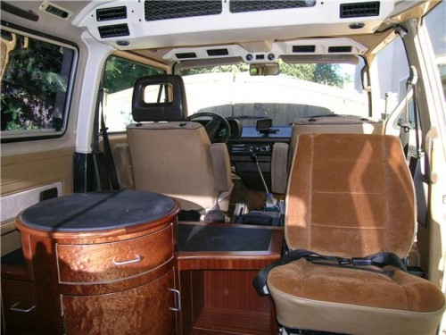 Custom Vanagon interior includes round table with drawers