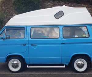 Baby blue high top with white wheels and bumpers