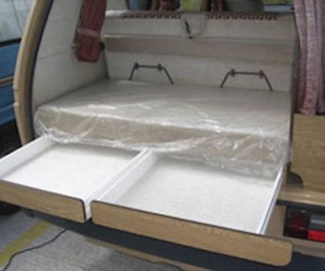 Rear compartment drawers