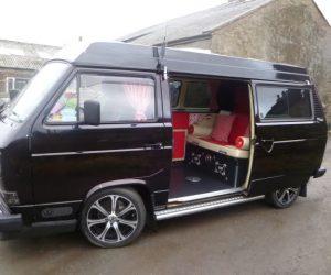 Gorgeous black T25 pop top with custom interior