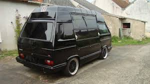 Black high top Vanagon with oversized side doors