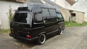 Black high top Vanagon with oversized side doors