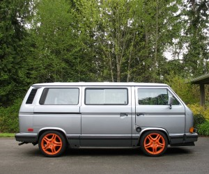 Orange Porsche Cayenne wheels on the Vanagon