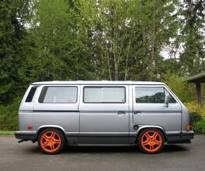 Orange Porsche Cayenne wheels on the Vanagon