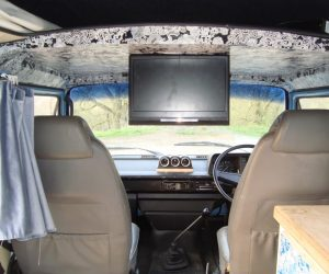 Baby blue camper with flip down TV
