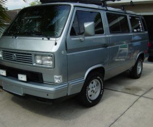 Silver Vanagon with painted bumpers and grill