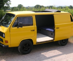 Yellow rag top Vanagon with custom wheels