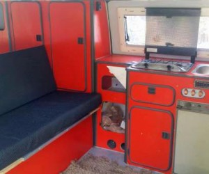 High top Vanagon with red cabinets