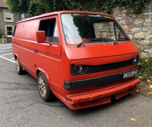 Red panel van with large eyebrow