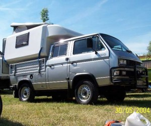 Silver double cab syncro with pop top rear camper
