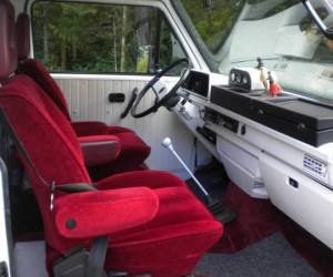 Red velvet seats and white dash board