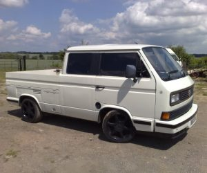 White double cab with blackout wheels