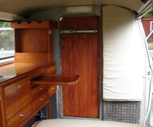 Custom Vanagon interior with a wine rack